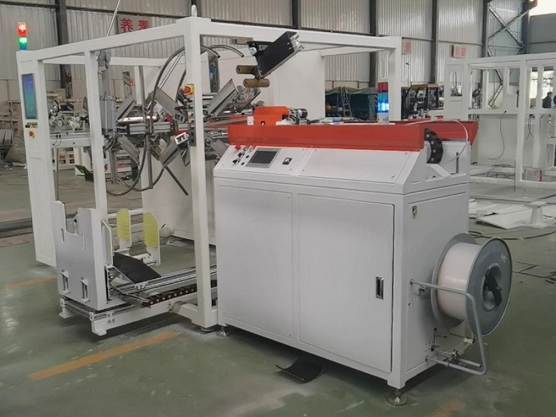 AUTOMATIC HDPE PIPE COILING AND STRAPPING MACHINE